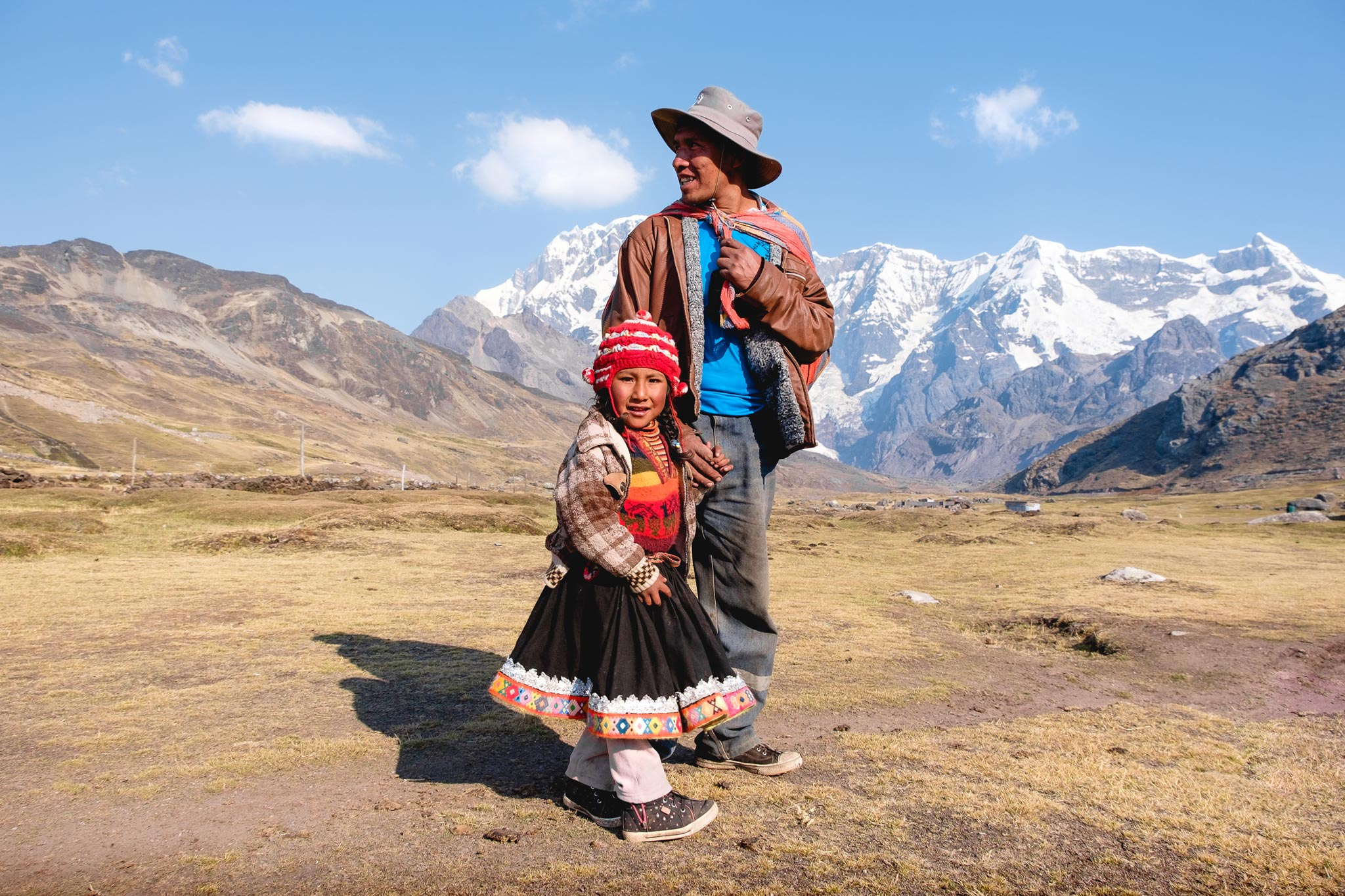 QUECHUA FATHER BRINGING HIS DAUGHTER HOME - AUSANGATE REGION - PERU