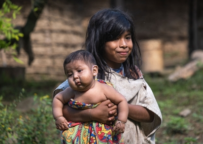 KOGI GIRL WITH A BABY IN THE SIERRA NEVADA DE SANTA MARTA