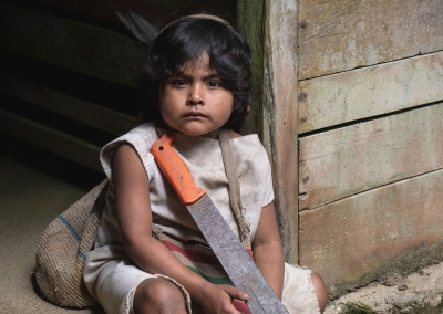 KOGI KID WITH A MACHETTE IN THE SIERRA NEVADA DE SANTA MARTA