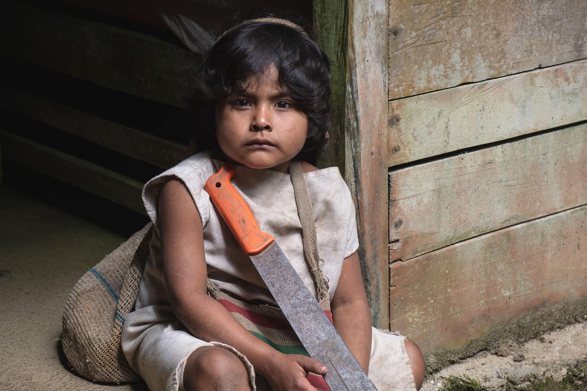 KOGI KID WITH A MACHETTE IN THE SIERRA NEVADA DE SANTA MARTA