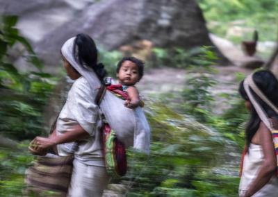 KOGI MOTHER WITH HER BABY IN THE SIERRA NEVADA DE SANTA MARTA