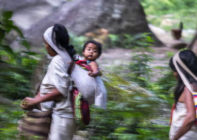 KOGI MOTHER WITH HER BABY IN THE SIERRA NEVADA DE SANTA MARTA